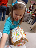 Making gingerbread houses at the JLNV's Enchanted Forest. (November)