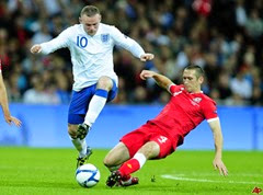 Wayne Rooney tackle playing for England