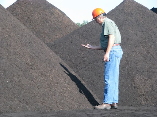 A City Utilities employee inspects the 50 ton pile of