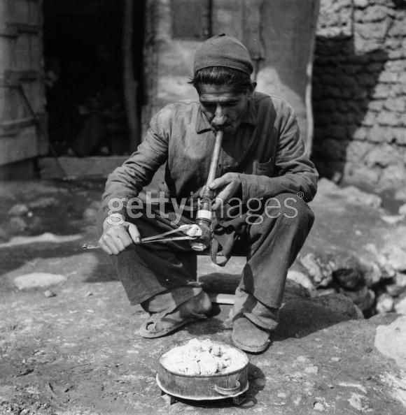 Opium Smoker circa 1955,A man smoking opium in a village in Iran. (Photo by Three Lions:Getty Images).jpg