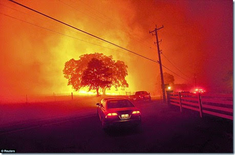 Residents flee as winds whip flames from the Morgan fire along Morgan Territory Road near Clayton, California, September 9 - Copy