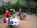 Kai and Kento riding the robots at Robot Park