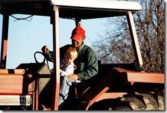 T and daddy on tractor 1