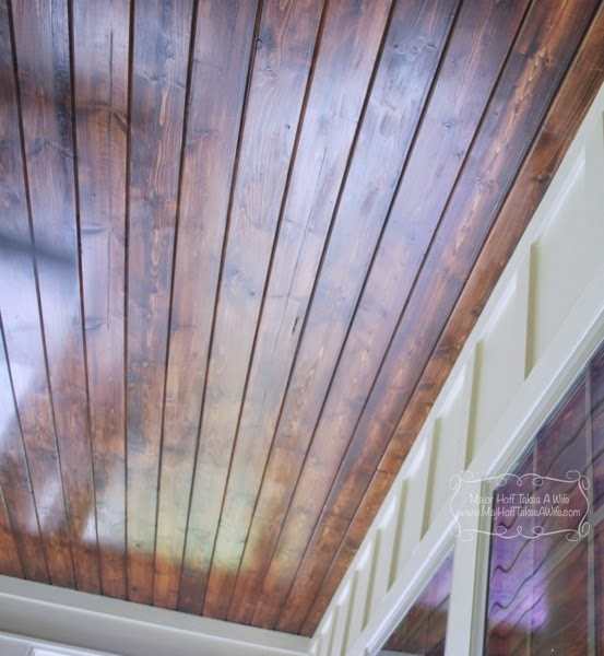 Planked stained wood ceiling on sun porch