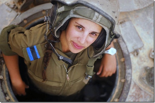 """""""Tank Instructor Says Hi"""". A tank instructor during her training course surfaces for a second to say hello, 2012."""