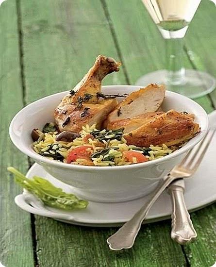Cosce di pollo con riso agli spinaci.