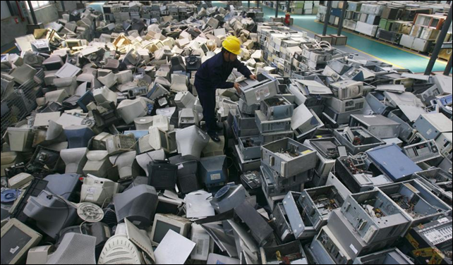 An employee arranges discarded computers at a newly opened electronic waste recycling factory in Wuhan, Hubei province, China. Photo: REUTERS