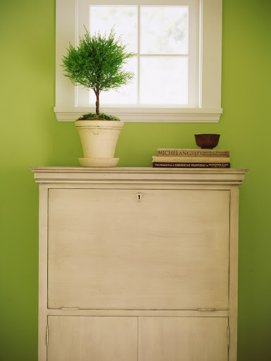 A secretary desk is perfect for a narrow hallway, as you can fold up your work space when it is not in use.