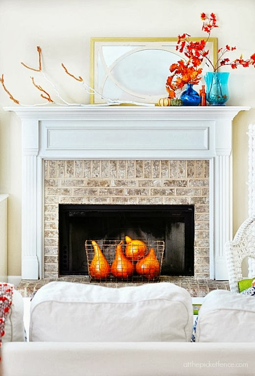 simple-fall-mantel-with-maple-leaves-and-painted-branch