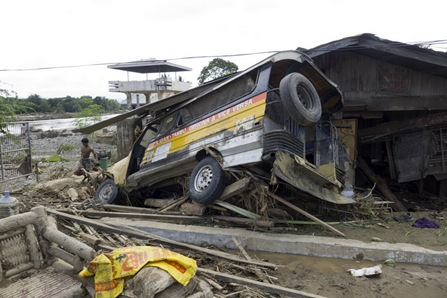 17IGNFLOOD4<br />A passenger jeepney in Barangay Filomena swept by the flood that hit Iligan City Saturday Dec. 17, 2011. MindaNews photo by Bobby Timonera<br />