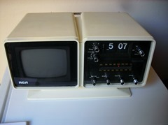 RCA portable black and white television and flip clock radio, ca. 1975