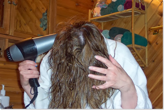 woman-drying-hair-hairdryer