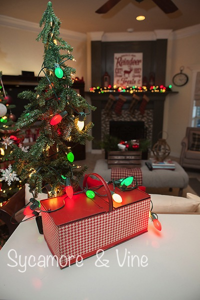 Vintage tin picnic baskets with lights for Christmas. A truly stunning Christmas Home Tour as part of the Christmas in the Country Blog Tour. This Plaid Inspired Country Christmas will knock your socks off. Features tours of the Living room, Dining Room and a Cocoa hot chocolate bar in the Breakfast room. There is so much inspiration for Christmas decorations in this one post. Be prepared to feel like you are cuddled up by the fire in a warm Northwoods comfy cottage! #country #Christmas #Plaid #Holiday decorating #Holiday ideas #Holidays #Christmas decor #Holiday decor