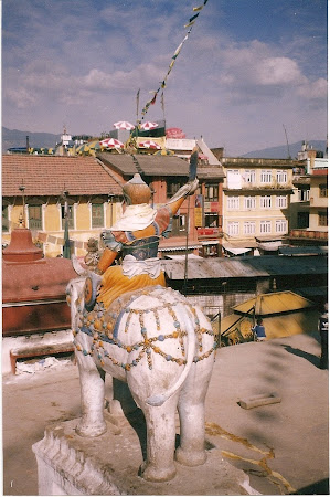 Things to see in Nepal: traditional statues near stupa