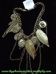 Antique gold charm necklace with leaves and medallions, hyphen