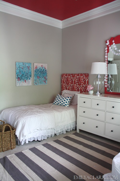 Teal & coral kids bedroom with abstract paintings