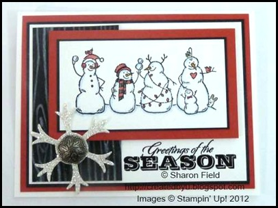 silver glimmer paper snowflake and antique brad added