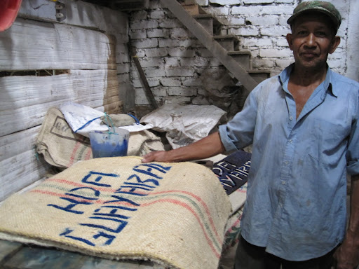One of the workers at the finca in the process of adding labels to the coffee sacks