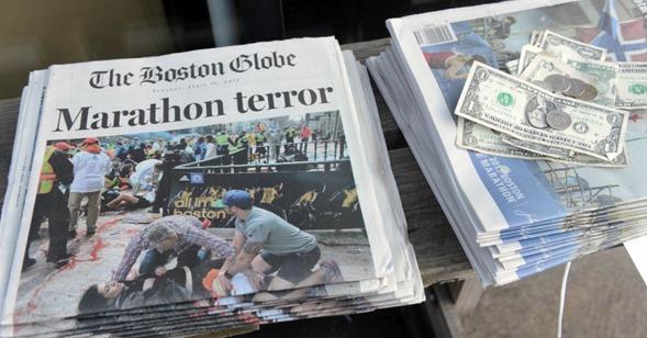 16abr2013---jornais-a-venda-na-newbury-street-em-boston-massachusetts-eua-noticiam-os-atentados-a-bomba-que-deixaram-tres-mortos-e-130-feridos-1366127694199_956x500