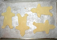 sugar cookie gingerbread men on sheet