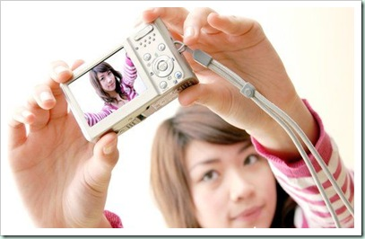Woman_taking_a_photograph_of_herself