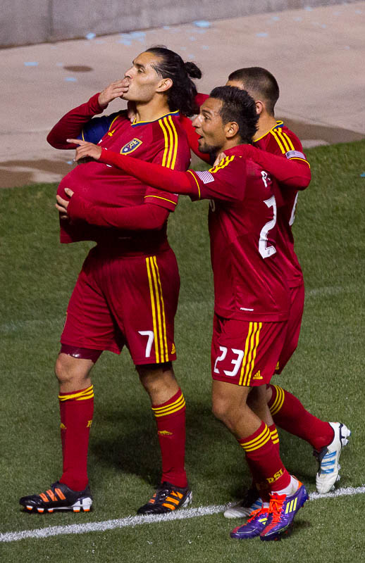 Real Salt Lake's Fabian Espindola (7) puts the ball under his shirt and blows a kiss to his pregnant wife after scoring a first half goal vs. New York Red Bulls