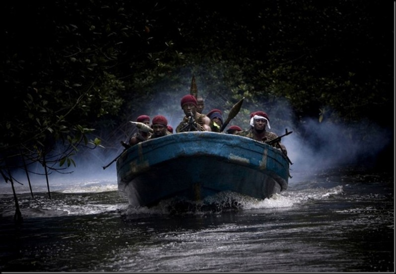 Militants led by Atek Tom - the leader of MEND - swim in the camp number 9 - one of 11 camps under the guidance of a leader in the mangrove forests of the Niger River