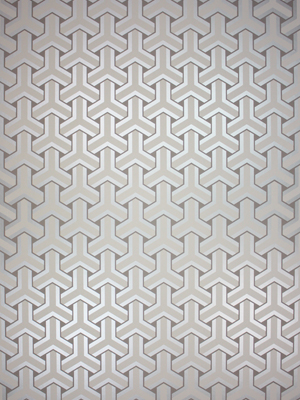 Their Trifid wallpaper features an interlocking Chinese key design with metallic sheen. (osborneandlittle.com)