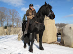 Martha and G.K. love horses! Here they are atop one of Martha's beautiful black Fresians.