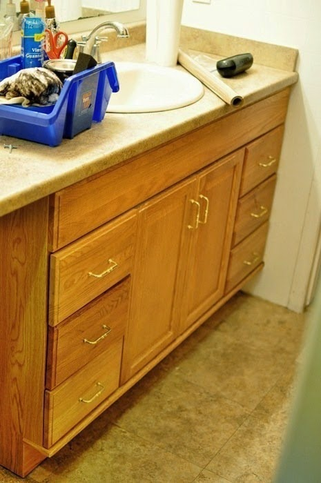 The best, most detailed tutorial for staining lighter cabinets a darker color. She uses espresso/java stain, but any darker stain works. Monica still replies to emails if you need help during your project!