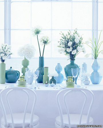 I love the soft glow that pervades this arrangement, with all its quirks and elements. (www.marthastewart.com)