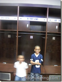 In the locker room in front Romo's locker. 
