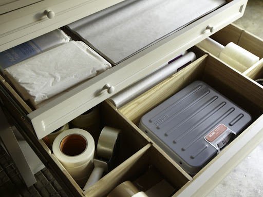 Two additional drawers hold all things for packing.  Acid-free tissue is a must for wrapping and storing items long term, especially clothing and linens.