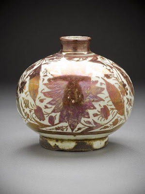 Vase Iran Vase, second half of the 17th century Ceramic; Vessel, Fritware, overglaze luster-painted, 4 3/16 x 4 3/16 in. (10.6 x 10.6 cm) The Nasli M. Heeramaneck Collection, gift of Joan Palevsky (M.73.5.193) Art of the Middle East: Islamic Department.