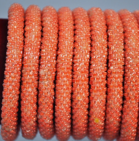 Rollover Orange Bead Bracelets
