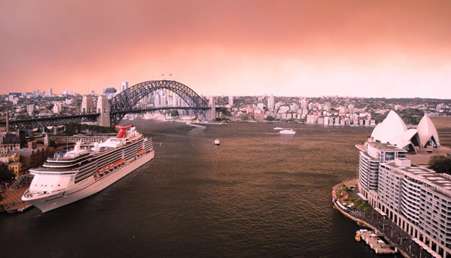 Smoke and ash from bushfires in the Blue Mountains turn the sky red over the Sydney Harbour Bridge, Opera House, and North Sydney, 16 October 2013. Photo: Alana Fisher / Twitter