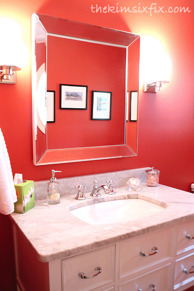 Red bathroom with marble