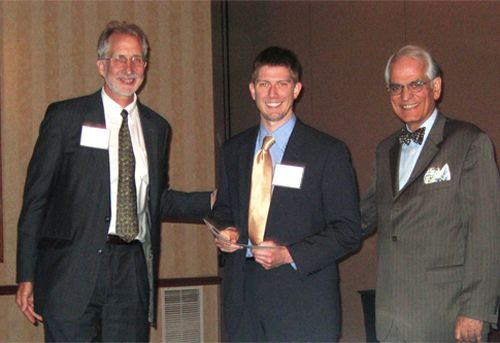 Erik Diringer accepts the award for third prize in research at the 2010 Research Symposium