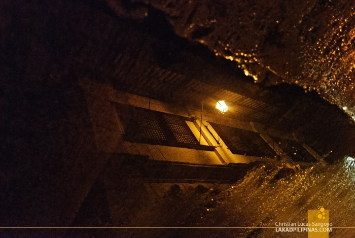 A Puddle Reflecting an Ancestral House