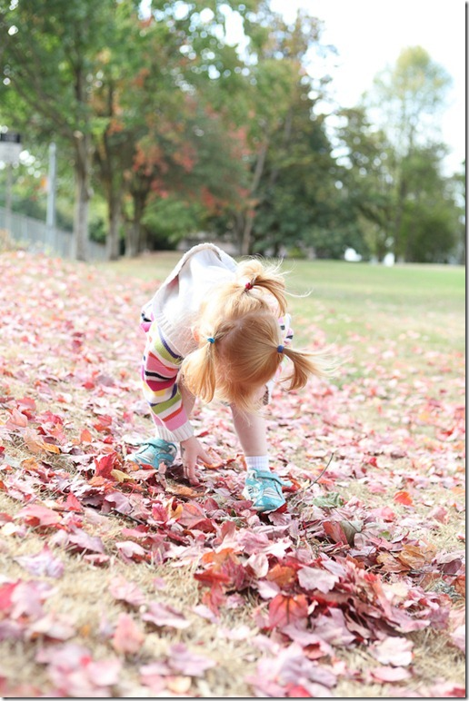 Sara throwing leaves (1)-blog