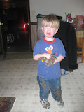 Boy meets mud puddle. He was having fun until he realized what a mess he was.