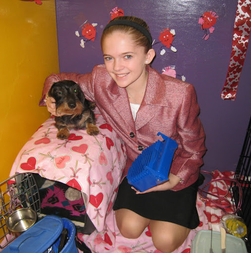 A junior handler with her Wire Haired Dachshund.