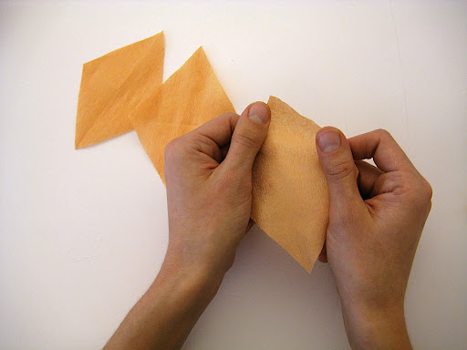 Stretch out the paper for each petal by tugging lightly across the grain.