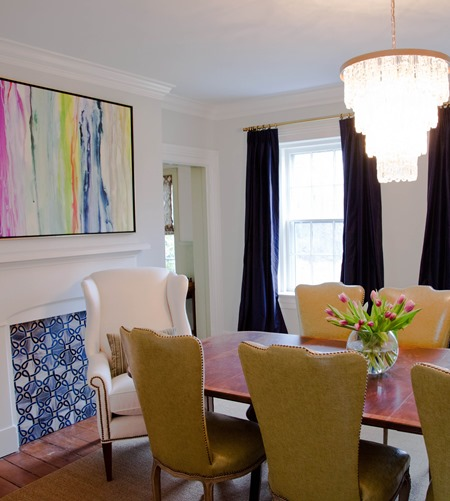dining room with abstract art and navy curtains