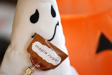 ghost plush doll with maple sugar lollipop