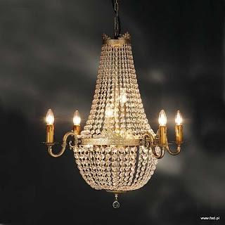 Żyrandol z kryształami. Wykończenie: stara miedź.. Wys 840 mm, Średnica 820 mm, Światło 10 x 40W E14 typu świeca.