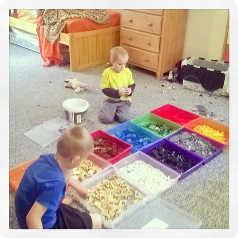 boys separating legos