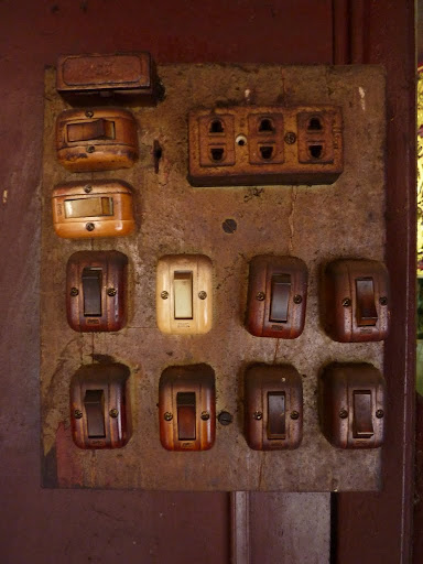 A collection of Vietnamese light switches. One of these destroys the world.