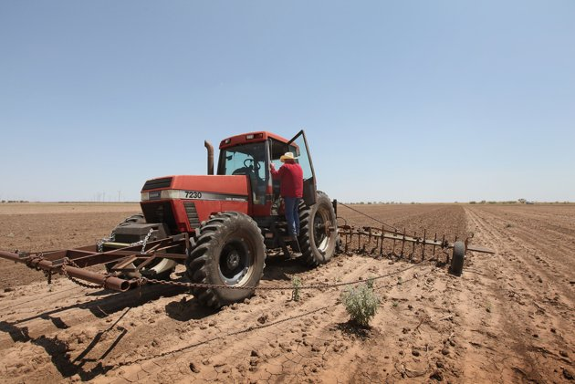 A farmer plows up a field where crops failed because of a severe drought in the region, in Texas in 2011. Scott Olson / AFP Photo
