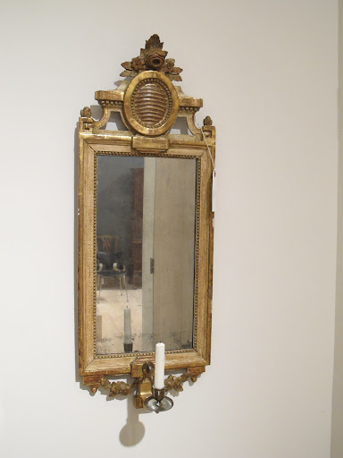 This Gustavian mirrored sconce (one of a pair) is circa 1780-1795.